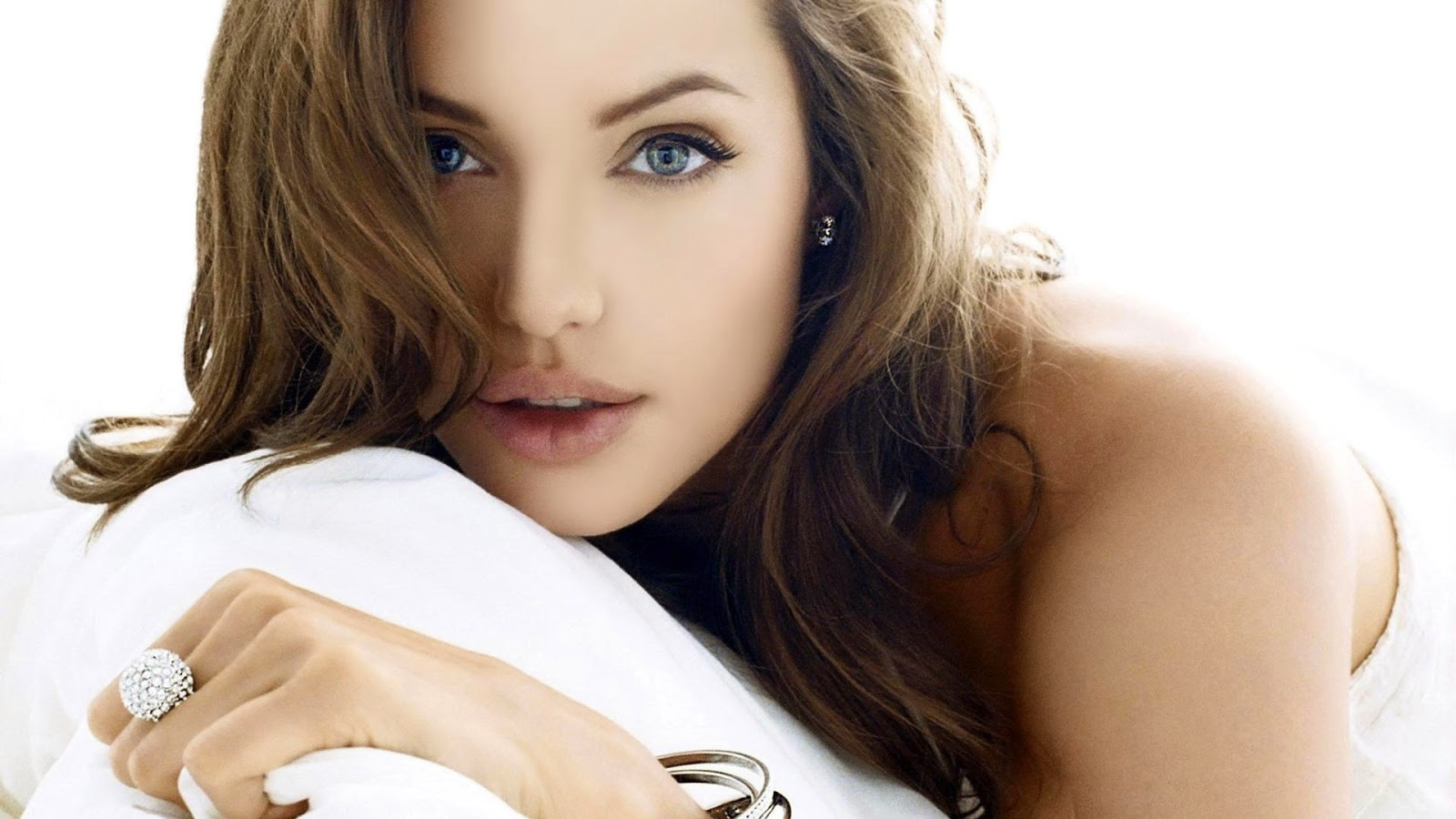 Hollywood Actress Angelina Jolie in bedroom Wallpaper