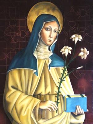 Imagen de Santa Clara con el lirio simbolo de su pureza