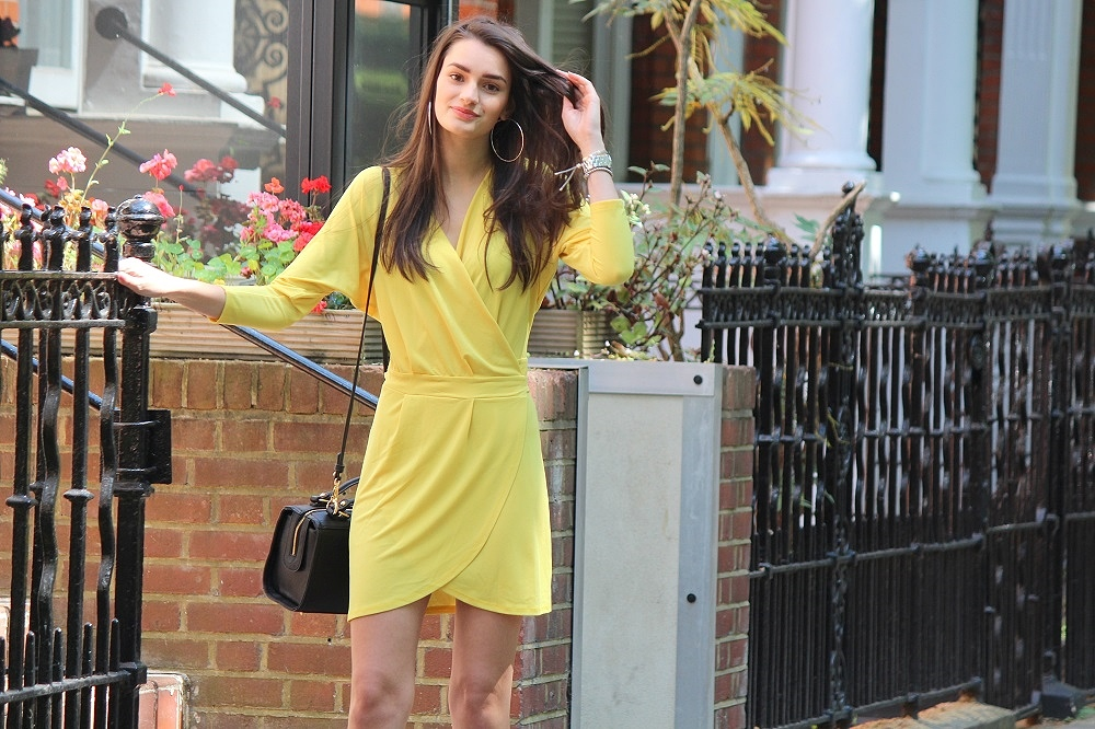 peexo-fashion-blogger-wearing-yellow-wrap-around-dress-and-black-bag