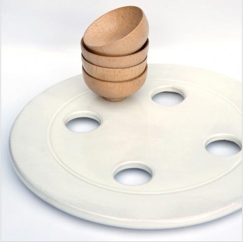 http://www.lovethesign.com/prodotti/tavola-e-cucina/accessori-cucina/mark-pepper/tagliere-bottone-faggio