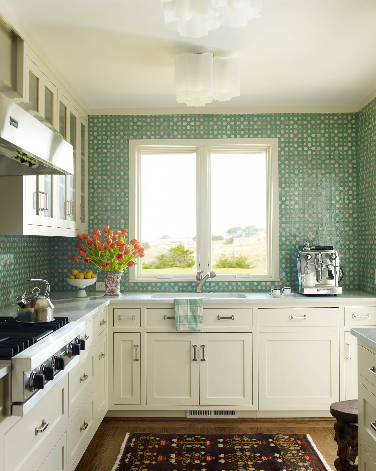 kitchen with aqua mosaic tiles from counter to ceiling backsplash
