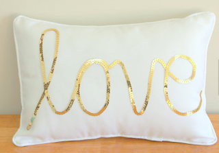 http://www.etsy.com/listing/101491839/gold-sequined-love-cushion?ref=shop_home_active