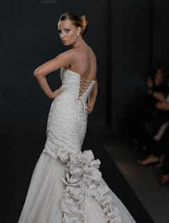 wedding dress with ruffled train