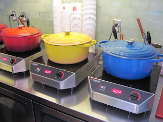 A lineup of dutch ovens simmer the meatballs for those dining in New York at Meatball Obsession