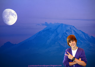 Justin Bieber Teen Singer Wallpaper of Justin Bieber Salutes the fans at Ascent Moon Blue Mountain desktop wallpaper