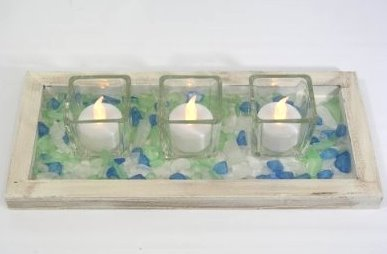 Tea lights on a bed of sea glass