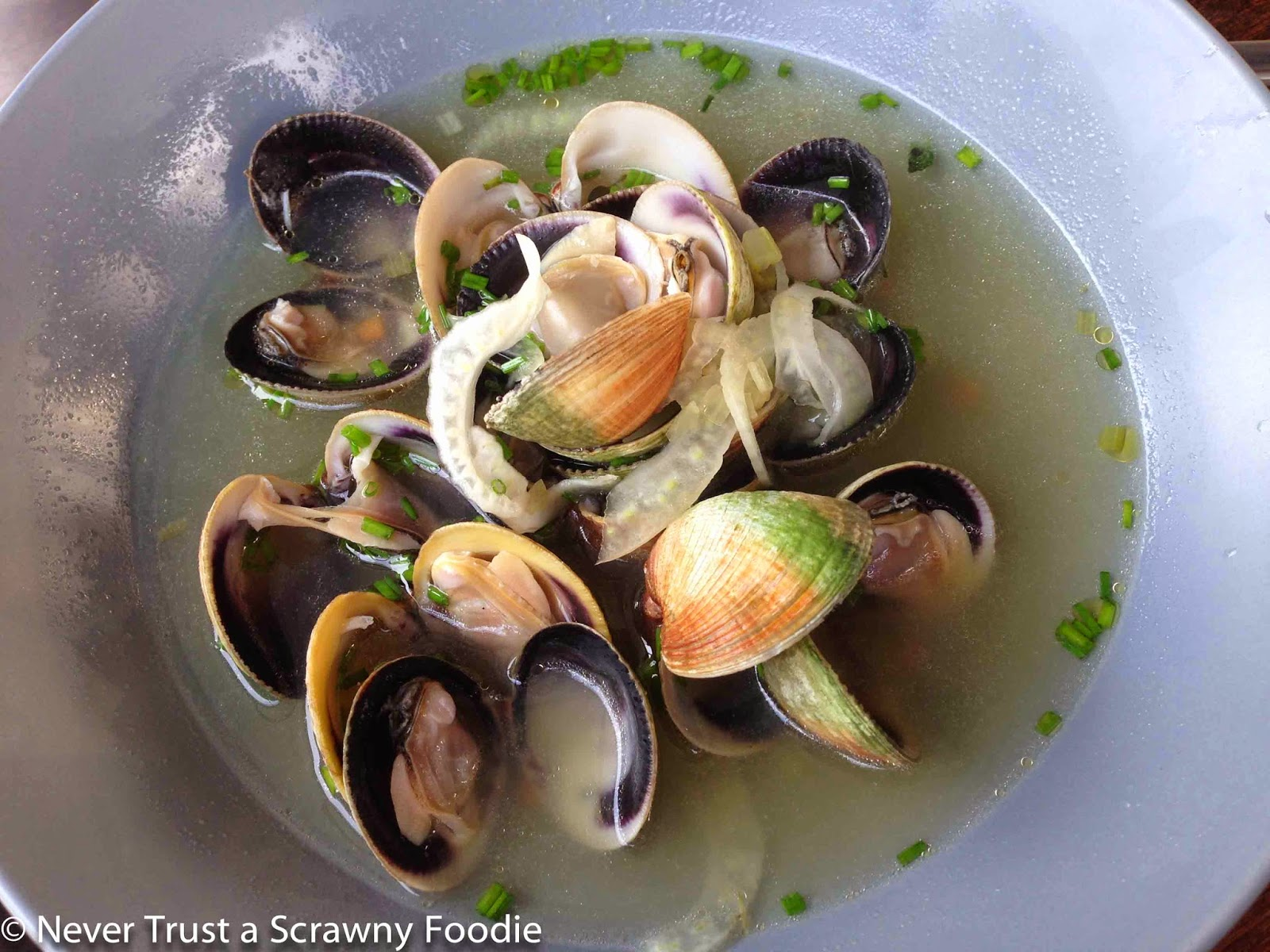clams in soup - light broth sweetened by the clams and a bit of fennel ...