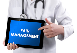 pain management sign held by doctor