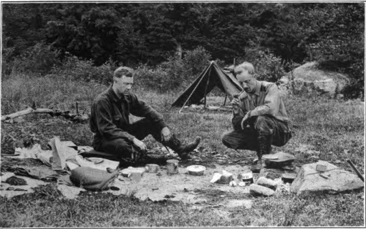 Arthur O. Friel and companion at their camp