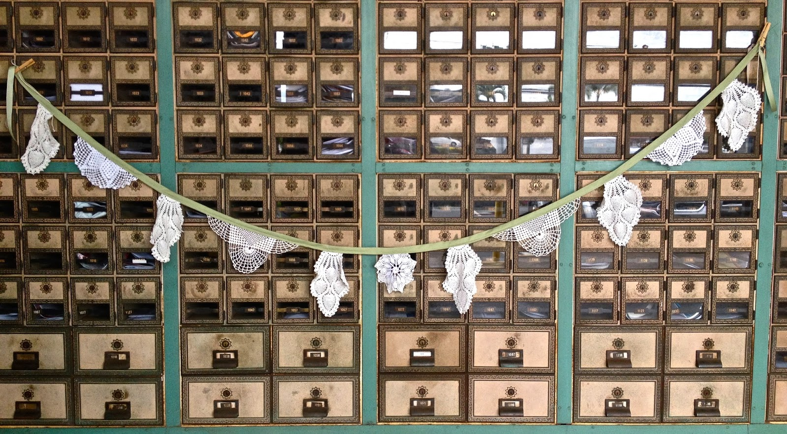 vintage doily garland on post office box