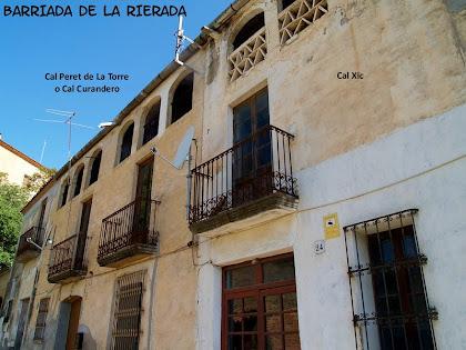 La casa de Cal Xic situada al costat de Cal Peret de la Torre
