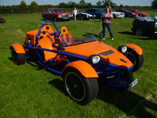 This Very Bright And Very Unusual Car Is A. MEV Rocket. It Is A Kit Car  With A Tube Space Frame Chassis And Can Be Built Using Parts From A Donor  Vehicle.