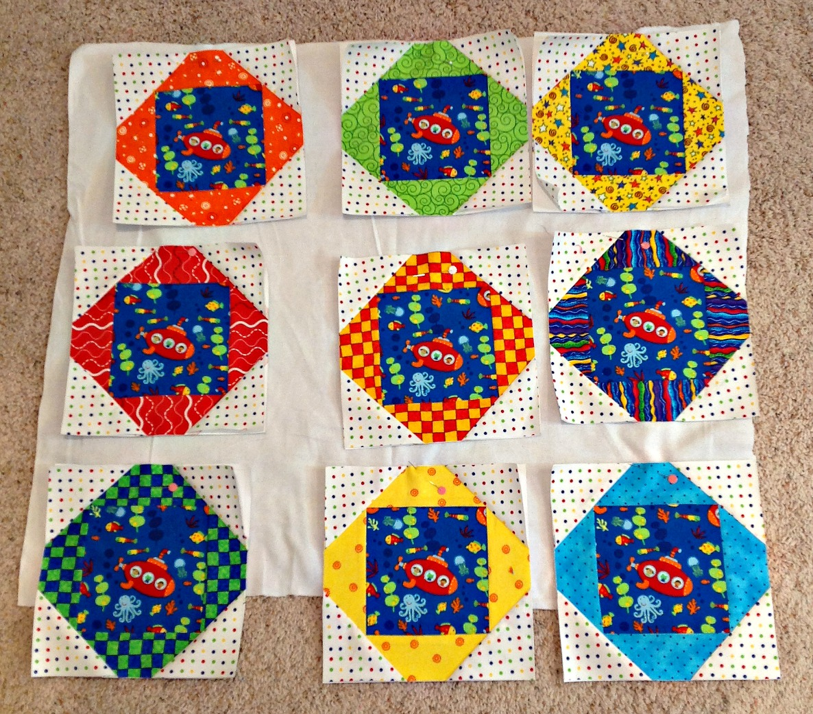 Jane 39 s fabrics and quilts baby boy quilt for Quilt material for boys