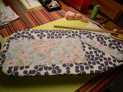 fabric pieces laid out on an ironing board for a little girl's headscarf