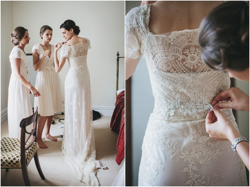 Bride putting on beautiful antique lace wedding dress
