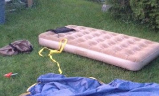 inflated twin air matress on the grass