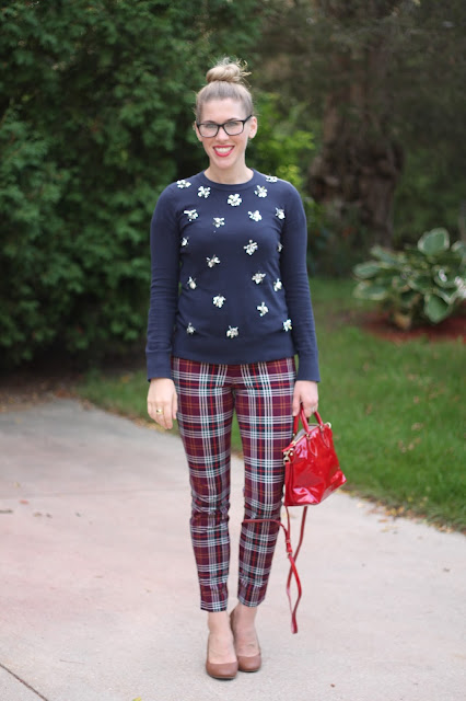 Navy embellished sweater, plaid pants, cognac wedges, red Dooney & Burke bag