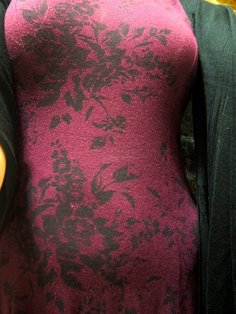 Fly Away | outfit close up shot of black floral design on dark purple dress