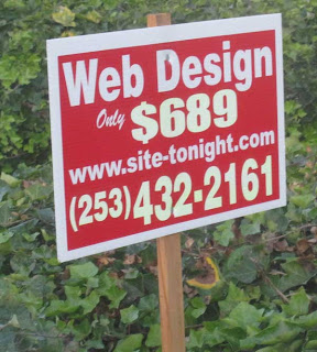 Red and white sign on a stick advertising web design for $698