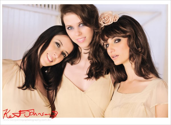 Three models, headshot, champagne colour brides maids dresses. Photographed by Kent Johnson.