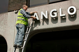 The Anglo Irish Bank office sign being taken down from its main Stephen's Green location in Dublin in 2011.