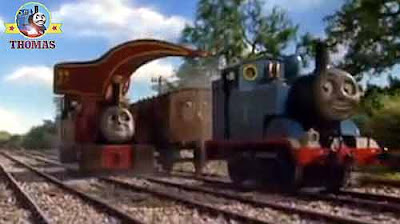 Harvey the crane passenger coachers Annie Clarabel and Thomas the tank engine on the railroad tracks