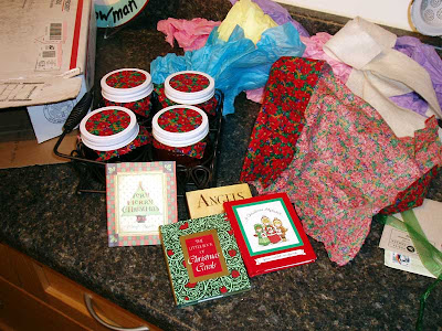 My Secret Santa gifts, homemade jams in a pretty metal caddy and four little books.