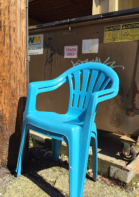 two blue plastic chairs