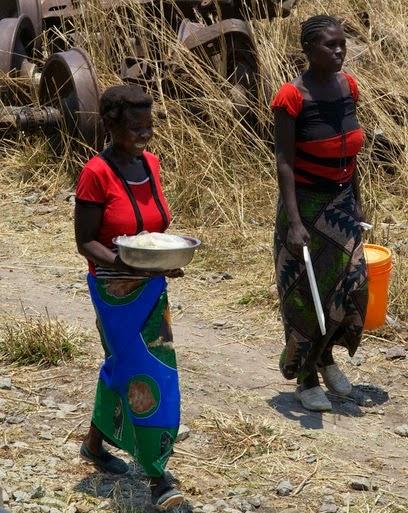 Zambia Africa roadside vendors by strings bass davie