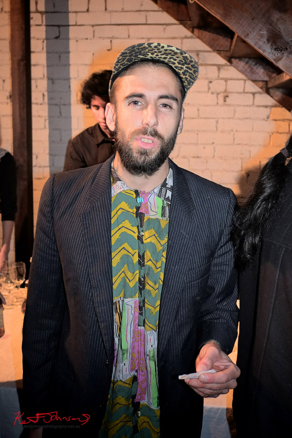 Men's groover style; leopard print cap, pinstripe jacket and funky 'tribal' print shirt.