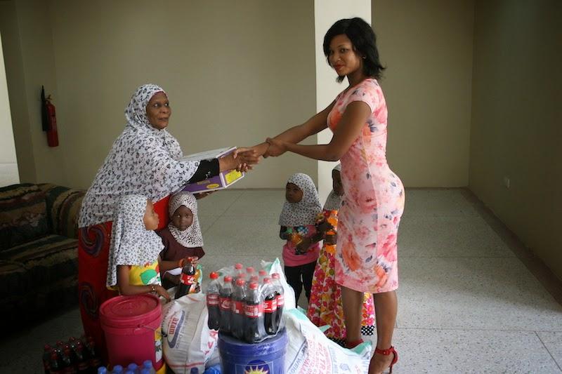 Miss Tanzania 2014 asaidia kituo cha New Life Orphans Home,Boko jijini Dar