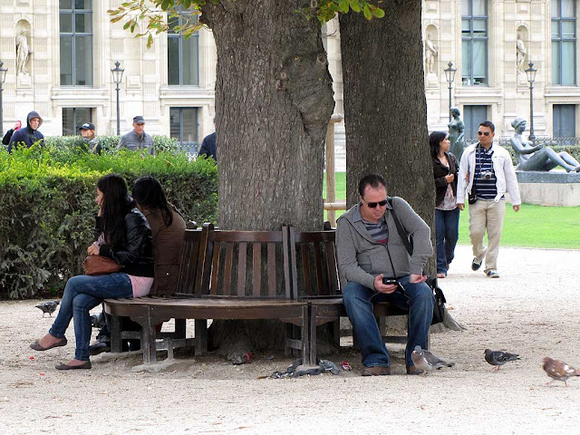 Busy bench around a tree, Tuileries Garden, Paris