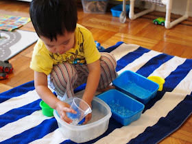 toddler playing with water beads