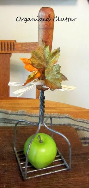 Repurposing a vintage potato masher as a wire cloche