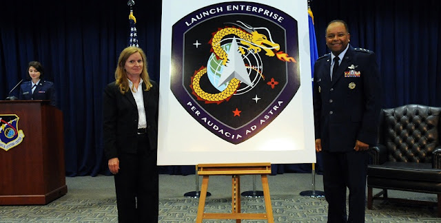 "Lt. Gen. Samuel Greaves, Space and Missile Systems Center commander and Air Force Program Executive Officer for Space and Dr. Claire Leon, the first director of the Launch Systems Enterprise Directorate unveil the new emblem during a brief stand up ceremony, Oct. 14. The Latin phrase, ""Per Audacia Ad Astra"" translates to ""Through boldness to the stars"" -- the new motto of the Launch Enterprise Directorate. (U.S. Air Force photo/Van De Ha)"