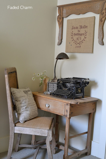 Faded Charm's desk and chair with a vintage typewriter