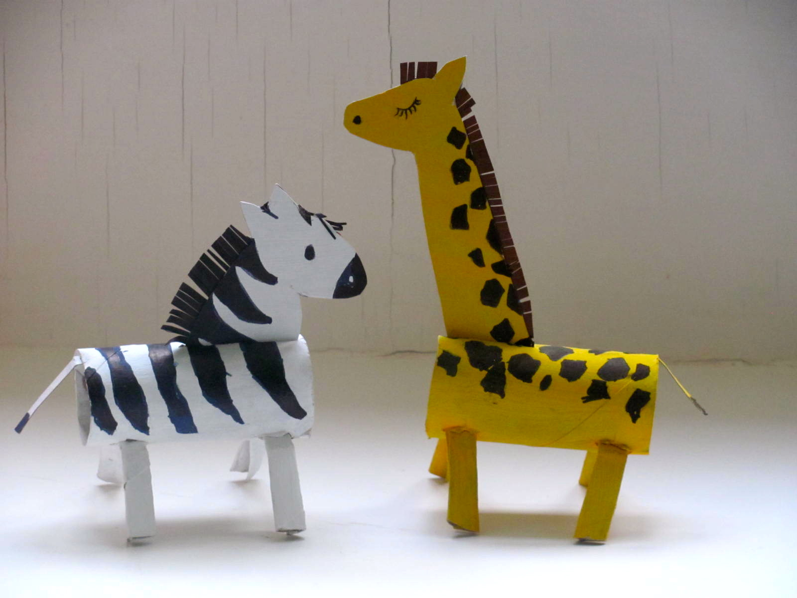 jumble tree: a giraffe and a zebra roll up to the zoo