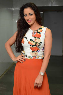 Ravaneeth Kaur in Orange Skirt and Floral Print Sleeveless Top at Sitara Audio Launch Cute Beauty