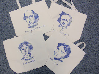Photo of our totebags with the drawings of famous authors on them.  The drawings were done by a  student library proctor.  Authors include: Shakespeare, Poe, Austin and Lee.