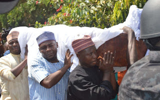 Abubakar Audu remains carried by his sons
