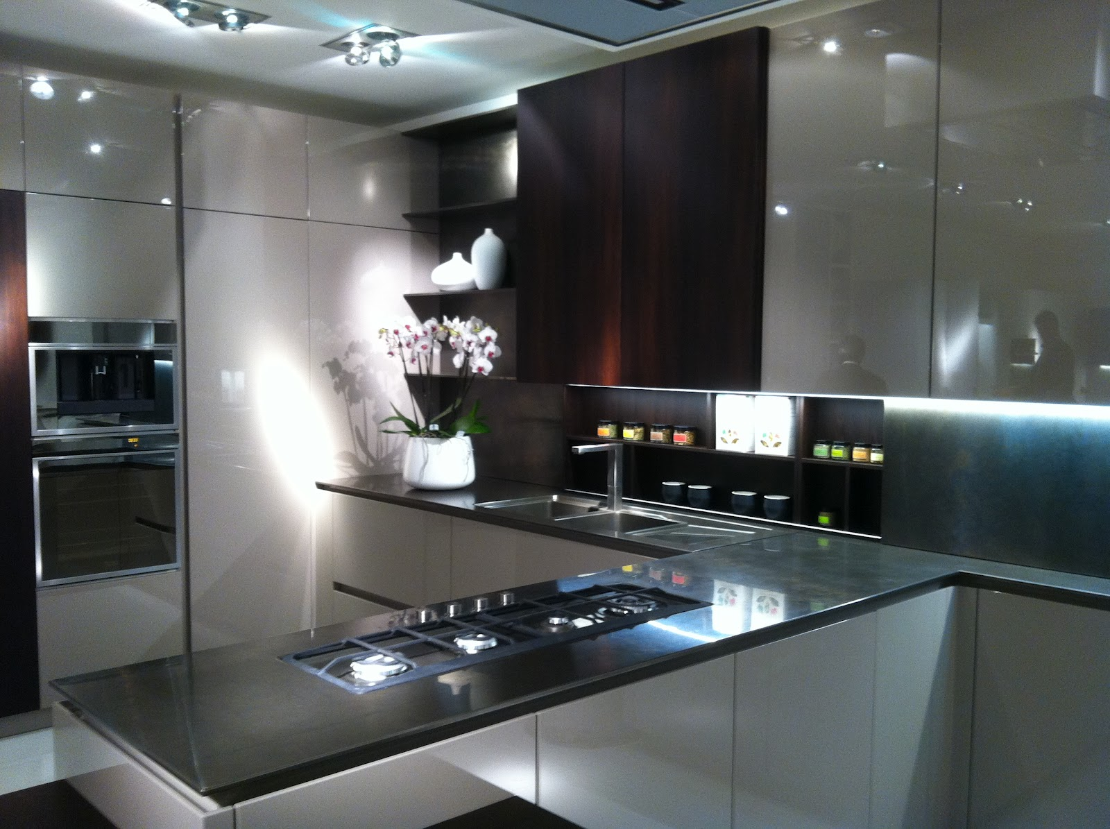 gold notes eurocucina 2012 guest post by cheryl hamilton gray unusual kitchen surfaces shown were concrete chiseled marble recycled paper and thin porcelain slab accent colors were predominantly in the battleship