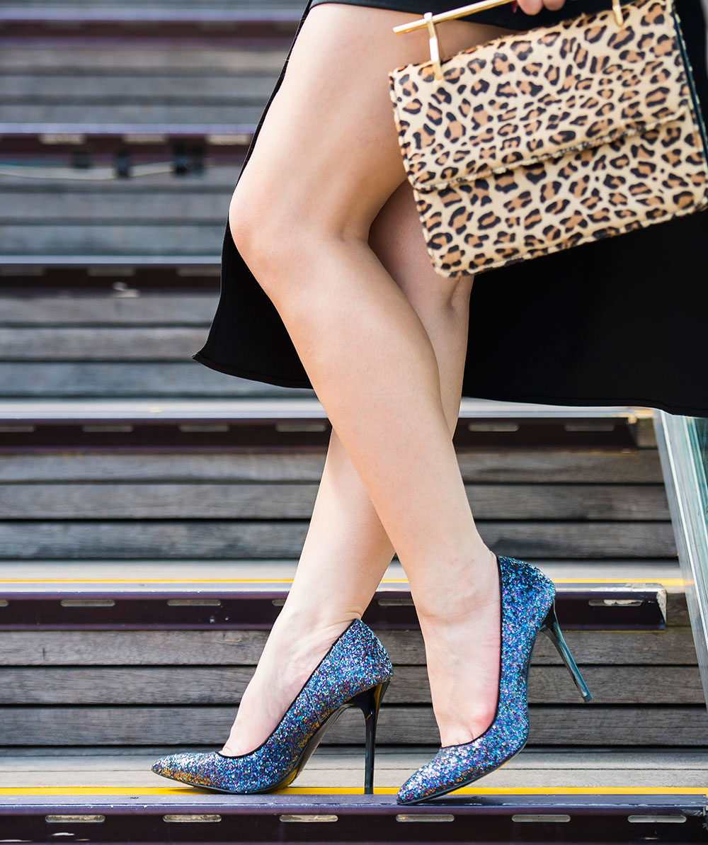 Crystal Phuong- Revolve Clothing- NBD Black Romper & Glitter Heels