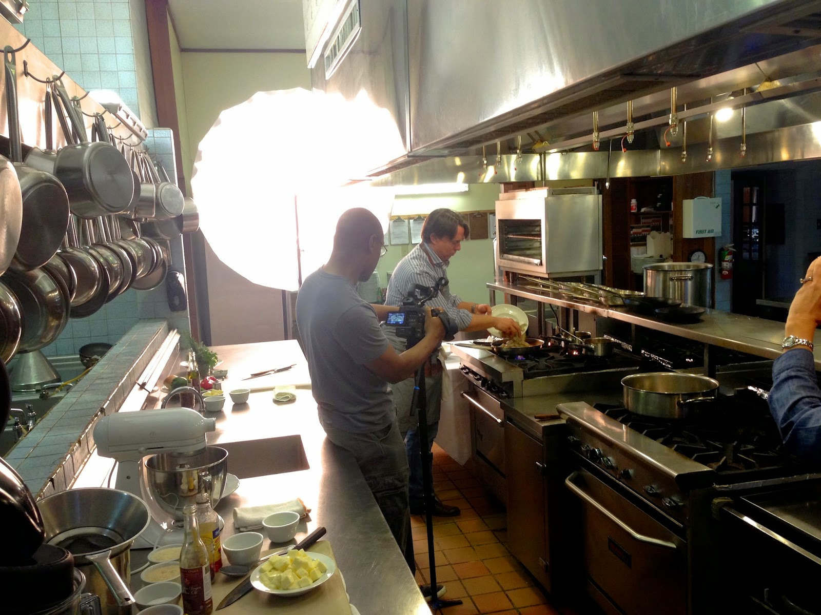 Dan Jones films Chef John Besh creating one of his signature dishes