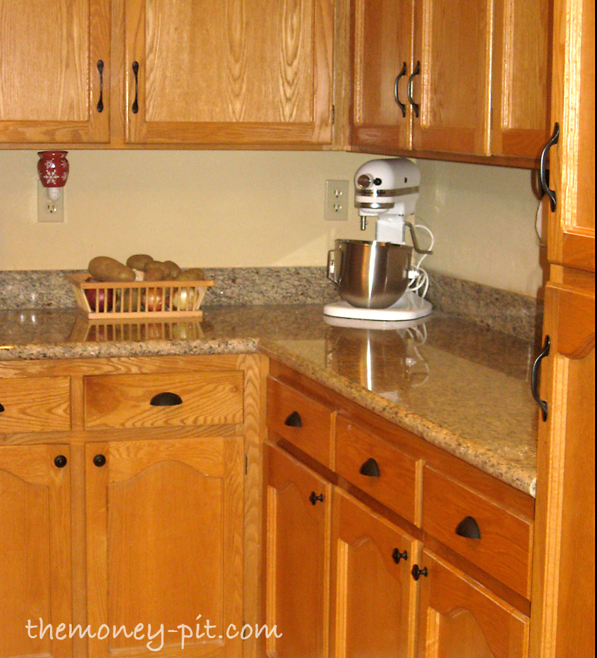 Updating cabinets with door hardware the kim six fix for Adding knobs to kitchen cabinets