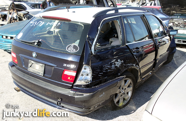The 2003 BMW Sport Wagon cost more than $30,000 when new. This wrecked Beemer sold for considerably less at auction.