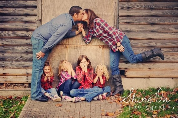 Ew! Mom and dad are kissing! This is a cute pose with kids giggling at ...
