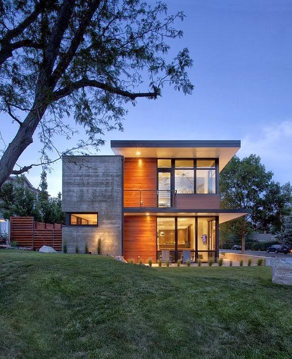 Casa dihedral fachadas de hormigon y madera por arch 11 for Diseno exterior casa contemporanea