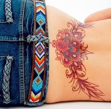 Handsome lower back tattoo for girls.