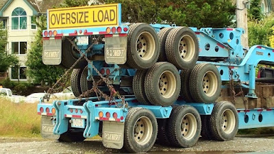 three heavy duty trailers stacked into an oversize load
