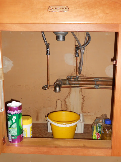 How to fix leaky pipes under your kitchen sink me ed for Leaky pipe carries more water